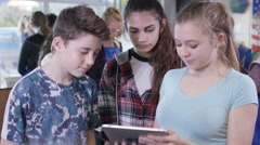 4K Portrait of teens looking at tablet computer in school science class - stock footage