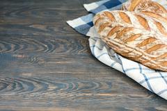 Homemade artisan sourdough bread on the wooden table - stock photo