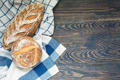 Organic artisan sourdough bread on the rustic table with free space on the right Stock Photos