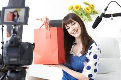 Female Vlogger Recording Broadcast At Home Stock Photos