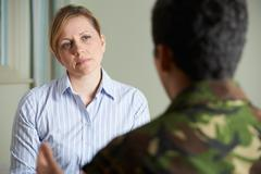 Soldier Suffering With Stress Talking To Counselor Stock Photos