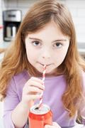 Young Girl Drinking Can Of Soda Through Straw Stock Photos