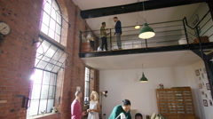 4K Young hipster business group working & brainstorming for ideas in loft office - stock footage