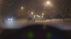 View from inside the car on the road during a snow. Night time, real time - stock footage