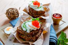 Red caviar with wholemeal bread. Stock Photos