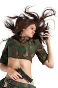 Beautiful army girl holding pistol and radio Stock Photos
