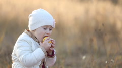 Child eating an apple - stock footage