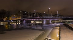 City traffic, moving blocks of ice in a river,  4K timelapse Stock Footage