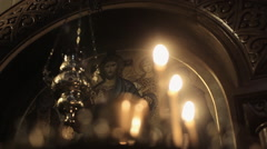Candles Are Lit Near Icons. the Image of Jesus. Stock Footage