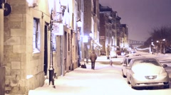 Winter time view of old Montreal - snow storm in the evening Stock Footage