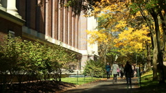 Harvard University. Students walking next to Harry Widener Memorial Library. Stock Footage