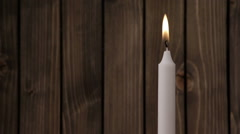 Light a candle closeup Stock Footage