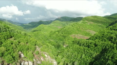 Aerial shot of beautiful green mountain hills covered with forest. Stock Footage