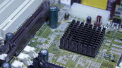 The microchip, the chip, the processor on the board rotates around the camera.  - stock footage