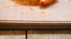 Grated carrots on a wooden board Stock Footage