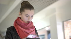 Blonde using tablet, smiling wearing. Urban female professional in her 20s. 4K Stock Footage