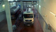 Milk truck in a dairy shop. Trucks with tank at milk farm. Dairy factory - stock footage