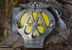 Stock Photo of Old AA or Automobile Association Car Badge