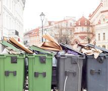 Plastic bins full of trash - stock photo