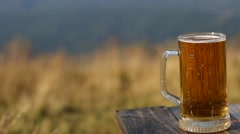 glass of beer on a table at the terrace bar - stock footage