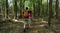 Couple Hiking In North Carolina Woods Stock Footage