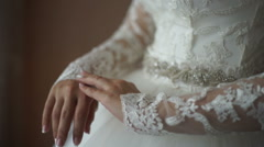 Bride corrects a dress, beautiful hands, gloves Stock Footage