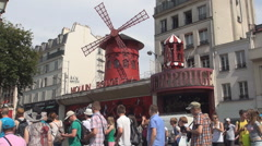 Stock Video Footage of Crowded Street Moulin Rouge Building Tourists Visiting Paris Famous Place