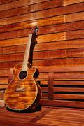 Acoustic brown guitar in wooden stripes Stock Photos