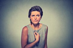 unhappy, annoyed young woman, getting mad asking question you talking to me - stock photo