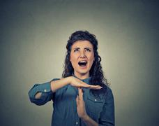Woman showing time out hand gesture, frustrated screaming to stop Stock Photos