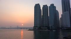 Marine City & Gwangan Bridge from the Dongbaek island at sunset. Busan Stock Footage