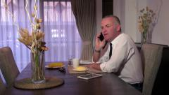 Man Business People With Ipad Telephone Mobile Phone At Breakfast Stock Footage