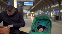 Father with babyunpacking bred on station  Stock Footage