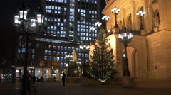 Walking and riding bikes in front of the Alte Oper on Christmas in Frankfurt Stock Footage