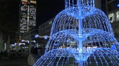 Decorated fountain on Große Bockenheimer Straße on Christmas in Frankfurt Stock Footage