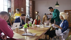 4K Portrait smiling hipster businessman working with colleagues in loft office Stock Footage