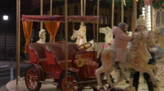 Children having fun at a carousel at the Christmas market in Frankfurt Stock Footage