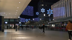 Walking next to MyZeil shopping mall on Christmas in Frankfurt Stock Footage