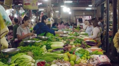 Locals purchase fresh produce at a public vegetable market, with sound Stock Footage