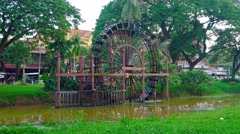Functioning water wheel on a canal in Siem Reap. Video 3840x2160 Stock Footage