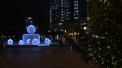 Riding bikes near a beautiful fountain in Opernplatz on Christmas in Frankfurt Stock Footage