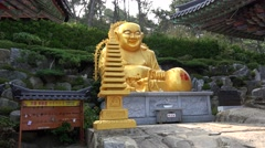Statue of Budai at the Haedong Yonggung Temple. Busan, South Korea Stock Footage