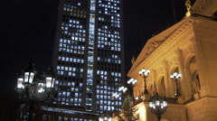Riding bikes in front of the Old Opera on Christmas in Frankfurt Stock Footage