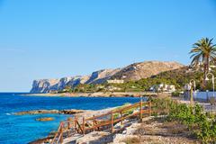 Denia Las Rotas beach in Mediterranean Spain - stock photo