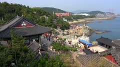 Haedong Yonggung Temple on the rocky coast. Busan, South Korea Stock Footage