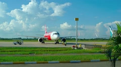 Ground crew servicing arriving Air Asia jetliner at Don Mueang Airport Stock Footage