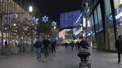 People walking by MyZeil shopping mall on Christmas, Frankfurt Stock Footage