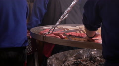 Cooking sausage products on a food stall at the Christmas market in Frankfurt Stock Footage