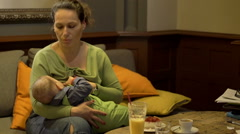 Mother breastfeeding the baby  - stock footage