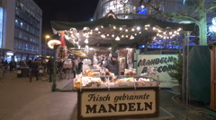 Stall with candied almonds at the Christmas market in Frankfurt Stock Footage